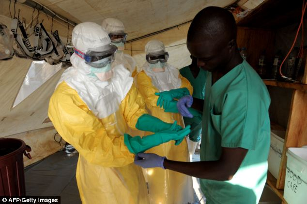 Health specialists work in an isolation ward for patients at the Médecins Sans Frontières