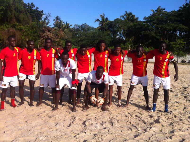 Uganda National Beach soccer team -sand Cranes line up for the game against Zanzibar on Sunday. Uganda won 5-4. L-R: Douglas Muganga (4) ,Kasujja Davis, Nkuubi Brian, Lukooya Baker,Naturinda Ambrose, Lavitah Jonie, Saudi Latif, Roch Somoka, Tekwo Derrick (Capt) In All white tops L-R: Bugembe Ashadu and Kalule Michael (Goalkeepers)