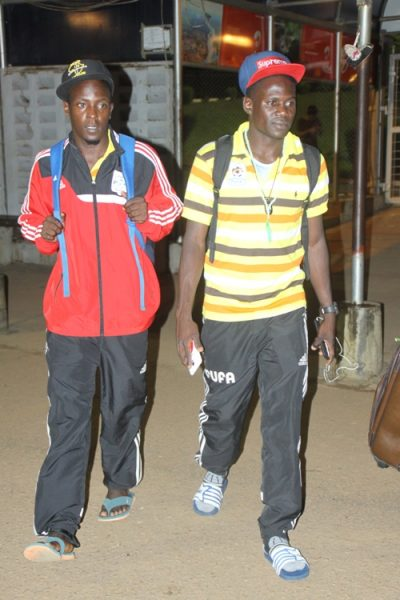 Farouk Miya (right) with a fellow player shortly after arriving at Entebbe International Airport.
