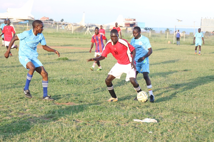 SFC's Kone Kisampugu dribbles past Air force players.