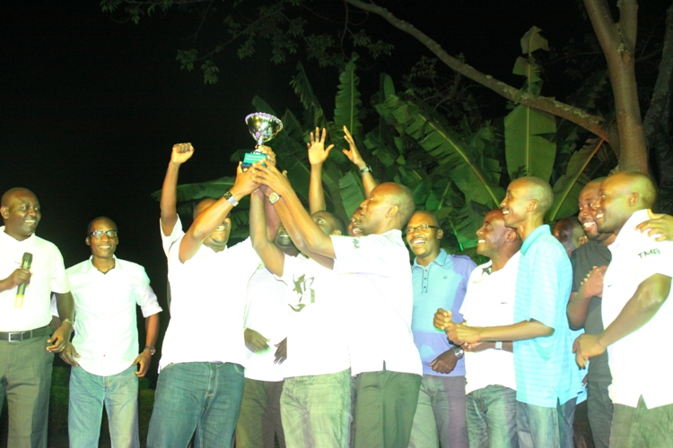 Team Kabalaza lifting the trophy high after being crowned champions.