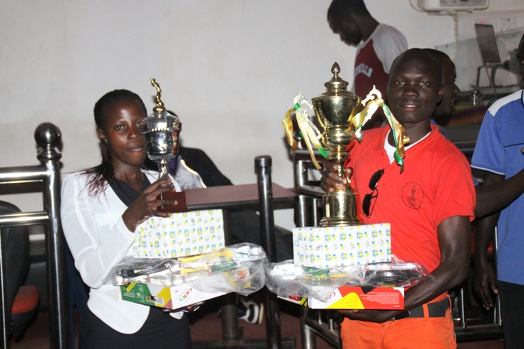 Agnes Namutebi (L) and Brian Omirambe (R) pose for photos with their prizes.