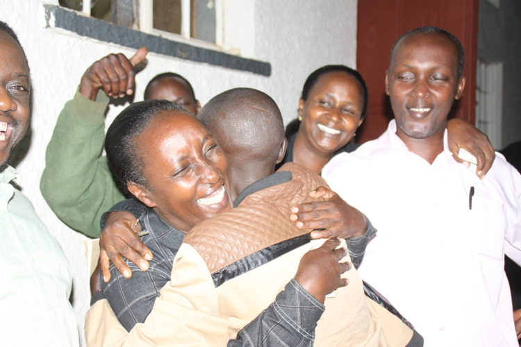 Rose Tumusiime receives a congragulatory hug from her diehard supporter.