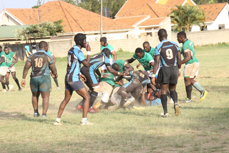 Mongers (in blue striped Jersey) take on Heathens at the Entebbe S.S Grounds.