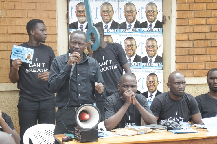 Former Entebbe Municipality member of parliament Gitta Alex (with microphone), John Mugabi (C) and former Mayoral Aspirant Miiro Kasozi during one the prayer meeting at the party office in Lugonjo.