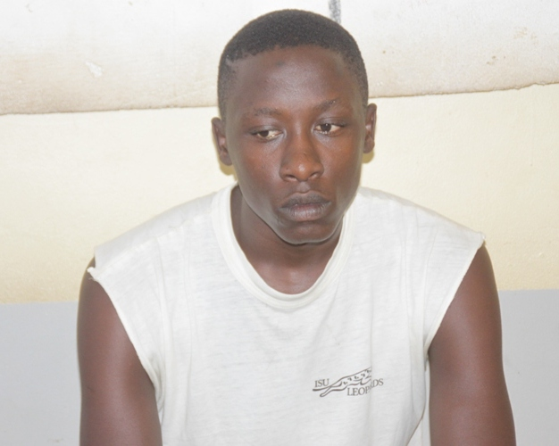Joshua Akandinda after he was arrested at Entebbe Police Station.