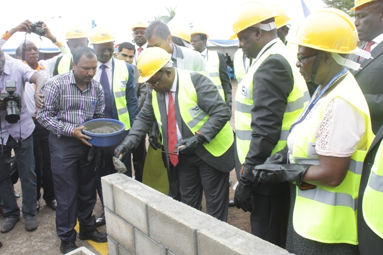 Minister John Byabagambi ground breaking. He cautioned the contractors against shoddy work.
