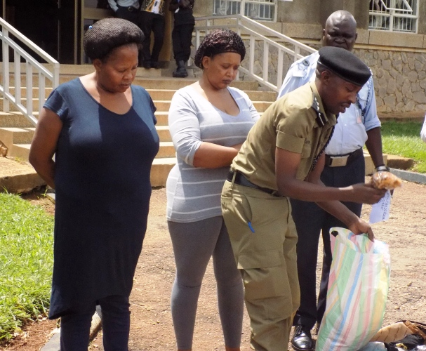 Afande Emilliane Kayima parades two female drug traffickers at the Entebbe Airport Aviation Police head quarters at who were arrested with illegal possession of narcotic drugs in November 2016.