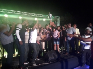 Entebbe Club players celebrate with trophy at the 19th hole.
