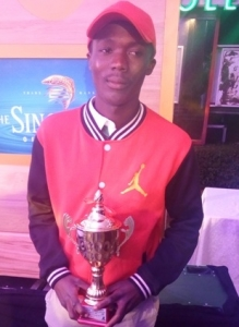 Herman Deco Mutebi with trophy after he emerged winner of the Singleton tourney