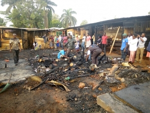 Vendors pick remains from the ashes after theNew Kitooro Market was burnt to ashes in the wee hours on Saturday Morning