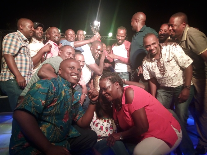 Entebbe club jubilate with trophy at the 19th hole.