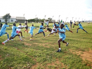CAA players warm up shortly before the match.