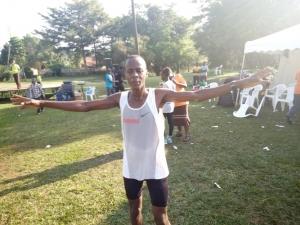Jonathan Akankwasa celebrates after winning the 21km race