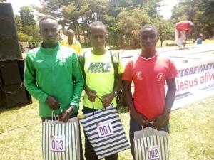 Jonathan Akankwasa (m), Saiga Alex (R) and Primo Agotre (L) topped the 21km race
