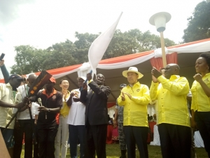 Vice President Sekandi Kiwanuka flagging off the Dragon Boat Competitions. He officially declared the Dragon Boat festival an annual event.