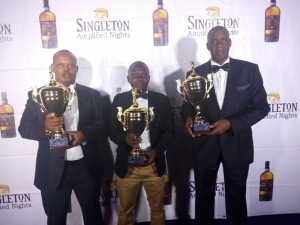 From left: John Muchiiri, Fred Wanzala and Isaac Mariera pose for a photo after they were crowned Champions.