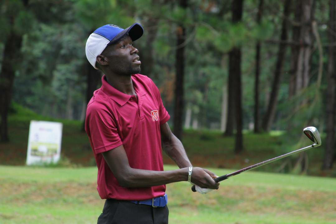 Uganda's Ronald Rugumayo watches his ball during day 2 action at the Victoria Cup in Entebbe. Kenya leads 9 points to Uganda's 7 going into tomorrow's final round of Singles. Photo by Timothy Okiror.