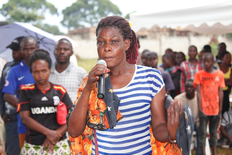 A Lady asks a question during a recent community security meeting in Kasenyi over the rampant murders in Katabi Town Council.