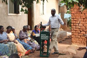 Arthur Namara explains to the benefits of using brickets as an alternative fuel source other than charcoal.