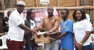 Rotaract Club Of Nkumba Stewards Hand over Scholastic materials to Kimmi Island LC1 Chief Abdul Karim On Saturday.