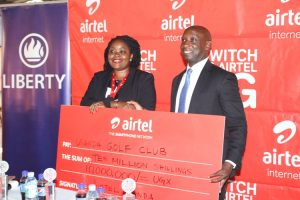U.G.C  Competitions Secretary Arthur Kiwanuka displays the Shs10m dummy cheque from Airtel with Airtel Brand and Communications Manager Remmie Kisakye.