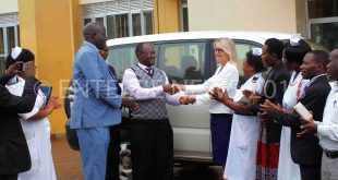 Dr. Muwanga Moses, the Entebbe General Hospital Medical Superintendent receives the vehicle from Suzanne Rupp, the MRC/UVRI&LSHTM chief operating officer on Thursday at Entebbe General Hospital. Next to Dr. Muwanga is Dan Fred Lutaaya(Entebbe Municipal Council Assistant Town Clerk)