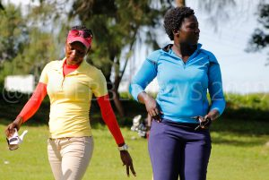 Dejected Martha Babirye (L) and Moureen Okura after they were knocked out of the Singleton Match Play Quarterfinal Round on Wednesday.