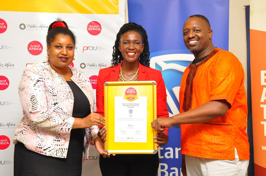 Cathy Adengo, Head of Corporate Communications at Stanbic Bank is flanked by Sarah Kagingo, the President Public Relations Association of Uganda and Joseph Kanyamunyu CEO Publics Africa communications pose for a photo