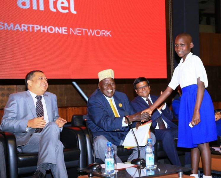 Gen. Moses Ali greets a pupil from one of Airtel's adopted schools during the launch of Airtel countrywide 4G
