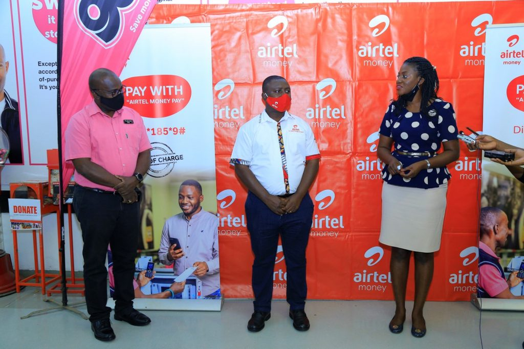(R-L) Airtel Uganda's Sumin Namaganda and Godfrey Muhindo joined by Game Store Manager Frederick Olwit during the launch of Airtel Money Pay at Game Stores in Kampala