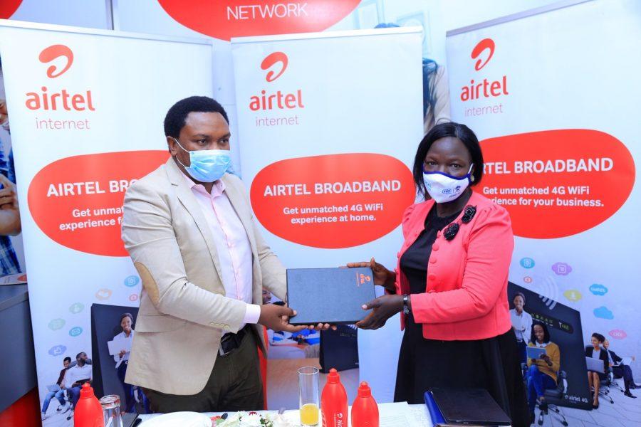Airtel Uganda General Manager, Broadband, Brenden Kachenje (left) handing over a token Lira Deputy Town Clerk, Rebecca Acen