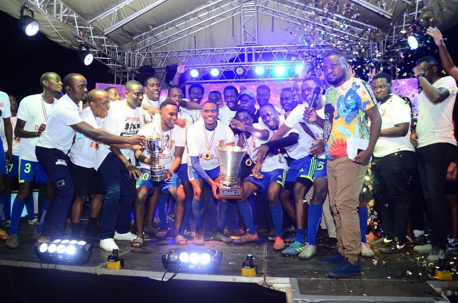 Winners Peaky Blinders with Guinness Uganda Brand Manager Elizabeth Mutamuliza middle in Black Shirt celebrating their win